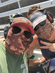 Two people attending the O'Riley Auto Parts  500 on 19 JUL 2020 at Texas Motor Speedway.  They are wearing mask and following the COVID-19 rules.