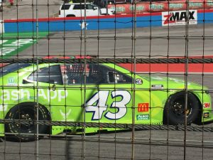 The number 43 Chevrolet Camaro ZL1 1LE Driven by Bubba Wallace for Richard Petty Motorsports sits on the front stretch at Texas Motor Speedway while the race was red flagged for a wreck.