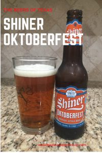 A pinterest image of A can of Hefe, a Shiner Oktoberfest beer from Spoetzl Brewery is next to a pint glass filled with a clear amber-orange beer with small white head floating on top.