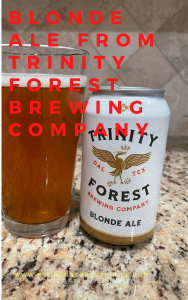 A Pinterest Pin of a can of Blond Ale from Trinity Forest Brewing Company is next to a pint glass filled with a clear golden beer with a thick head floating on top.