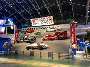 A wall of racecars in the Motorsports Hall of Fame of America