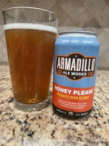 A can of Honey Please from Armildo Ale Works is next to a pint glass filled with a golden beer with a white head floating on top.